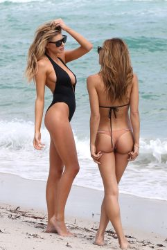 Charlotte McKinney flaunts her curvaceous figure while enjoying the beach with her friend